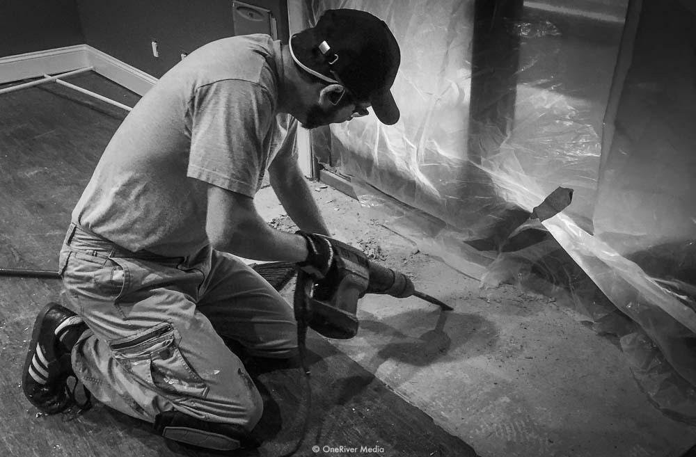 Marco Solorio installing flooring at OenRIver Media